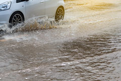 Wheels car sped through flooded. Royalty Free Stock Photos