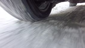 Wheels of a car traveling on winter roads stock video
