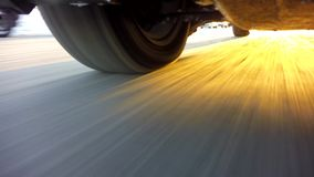 Wheels of a car traveling on winter roads stock footage