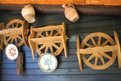 Wheels and ceramic. Traditional romanian handicraft objects hanging on the wall Stock Images