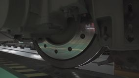 Wheels on chassis of train wagons at workshop in factory. Modern transportaion concept stock video footage