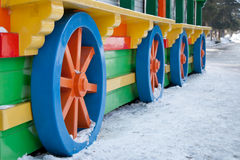Wheels. Colorful blue and orange wheels of the wagon Royalty Free Stock Photos