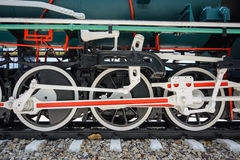 Wheels and connecting rod of old steam locomotive Stock Image