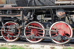 Wheels and coupling dyshla of the ancient engine. Fragment. Close up Stock Photos