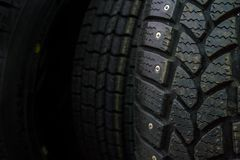 Wheels disks in the car dealer. The wheels hang in the window. Stamped disks and cast disks.For movement comfortable and strong. Tire service is free of charge Stock Image
