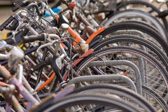 Wheels and frames. Telephoto of a group of parked bicycles in Amsterdam Stock Photos