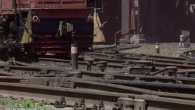 Wheels of a freight train traveling slowly on rails. The wheels of the freight train slowly move along the rails through the territory of the metallurgical plant stock video footage
