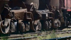 Wheels of a freight train traveling slowly on rails. The wheels of the freight train slowly move along the rails through the territory of the metallurgical plant stock video