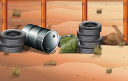 Wheels and fuel containers near the barbwire fence Royalty Free Stock Photography