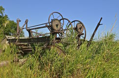 Wheels and gear of an antique road grader Stock Images