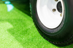 Wheels on the grass green. Stock Photos