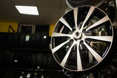 Wheels disks in the car dealer. The wheels hang in the window. Stamped disks and cast disks.For movement comfortable and strong. Tire service is free of charge Royalty Free Stock Photos