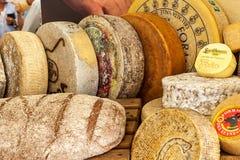 Wheels of hard cheese. Royalty Free Stock Photos