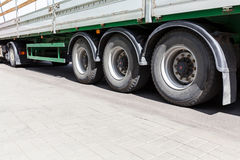 Wheels of heavy truck with trailer on gray asphalt road Royalty Free Stock Photos
