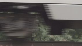Wheels of high-speed trains. Close-up wheel speed passenger train shooting in slow motion 400 fps stock footage
