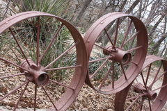 Wheels. This is at Holland Lake Park in Weatherford Texas. I walked here several times. There are a couple of Log Cabins to view and take pictures of here at Royalty Free Stock Photo