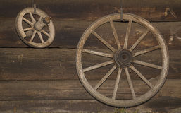 Wheels. Of horse-drawn coach at a wall of a log house Royalty Free Stock Images