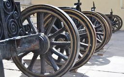 Wheels lined of  canons Stock Image