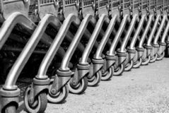 Wheels of metal shopping carts. Row of wheels one behind the other off a shopping mall Stock Images