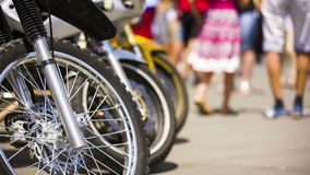 Wheels Of Motorbikes Standing in a Row stock footage