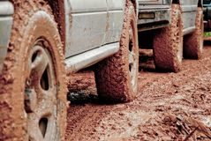 Wheels of Off road vehicles with mud royalty free stock photography