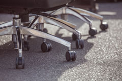 Wheels. The wheels on office chairs standing on the pavement Stock Images