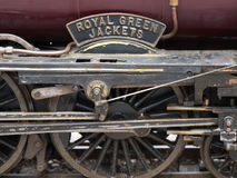 Wheels of old locomotive engine. With sign Royal Green Jackets royalty free stock photo
