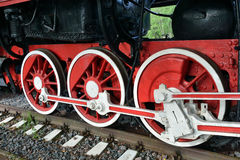 Wheels of the old steam locomotive. Photo of the wheels of the old steam locomotive Stock Photography