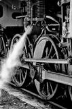 The wheels of the old steam locomotive. Steam locomotive wheels (black and white Stock Images