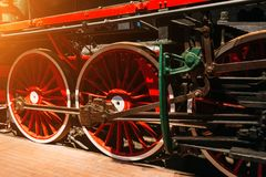 Wheels of an old steam locomotive close up. Stock Images