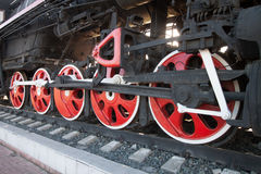 Wheels of an old steam locomotive. Stock Image