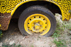 Wheels Old yellow car had a flat tire Royalty Free Stock Image