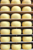 Wheels of Parmesan cheese are told in the shops Royalty Free Stock Photography