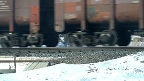 Wheels of a passing freight train. The wheels of a passing freight train stock footage