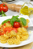 Wheels of pasta with fresh tomatoes Stock Photography