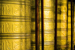 Wheels for prayers in buddhist temple. Tibetan buddhism in western sichuan, china Royalty Free Stock Photo