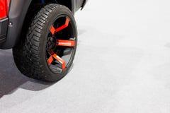 Wheels, red on white carpet. Wheels, red on white carpet in soft light Royalty Free Stock Image