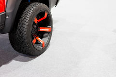 Wheels, red on white carpet. Wheels, red on white carpet in soft light Stock Photos