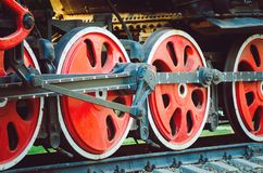 The wheels of the retro locomotive of red color, close-up stock photos