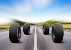 Wheels rush on speed road Stock Photos
