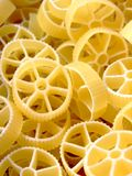 Wheels shaped pasta. Close-up of raw wheel shaped pasta Royalty Free Stock Photography