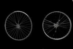 Wheels spinning, idle effort. Black background stock image