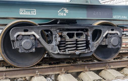 Wheels springs and truck at a railway car on rails Stock Images