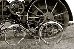 Wheels of a steam engine an vintage bicycle Royalty Free Stock Photography