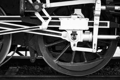 Wheels of steam locomotive, black and white. Wheels of steam locomotive with the power parts, stylized black and white photo Stock Images