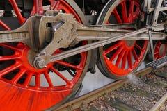 Wheels of steam locomotive. Detail of red wheels of steam locomotive Royalty Free Stock Image