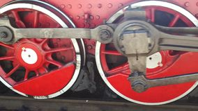 Wheels of the steam locomotive. Starting to move stock video