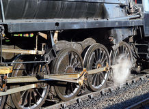 Wheels and steam from a train or locomotive. Royalty Free Stock Photos