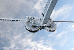 Wheels and steel cable iced. Wheels and steel cable frozen under blue sky Royalty Free Stock Image