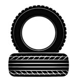 Wheels and tires are black. For a logo or emblem of a tire store or car workshop. For tire fitting. stock photography